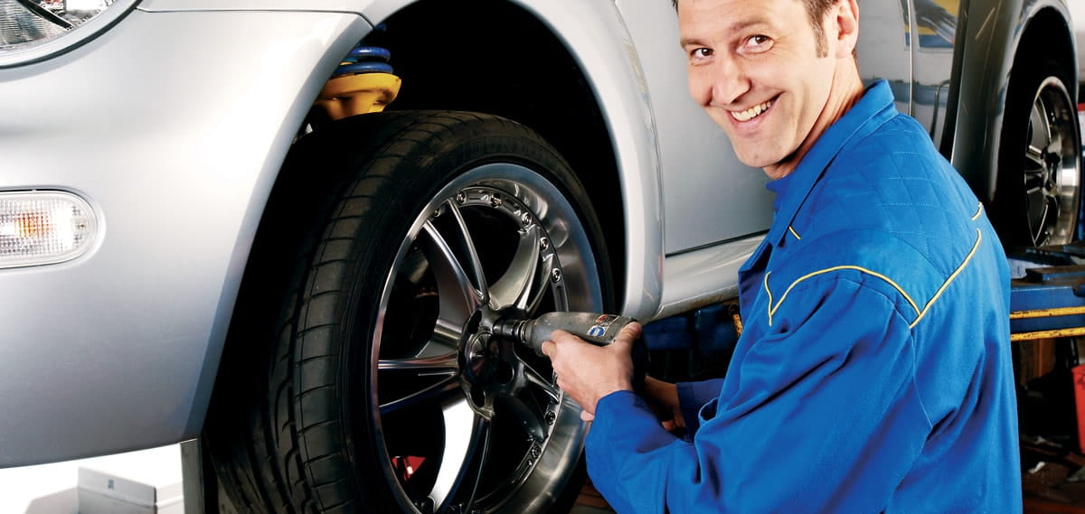 trained professional installing tire